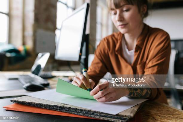 Close-up of woman working in startup business