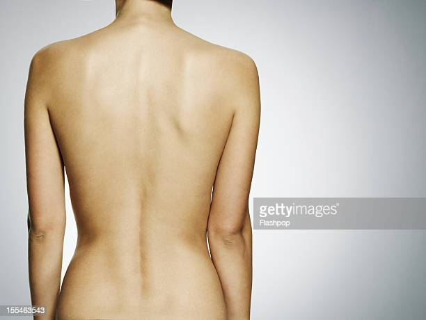 close-up of woman's back - dorsale foto e immagini stock