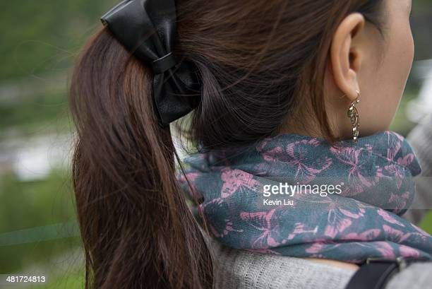 close-up of woman's back with butterfly scraf - hair bow stock pictures, royalty-free photos & images