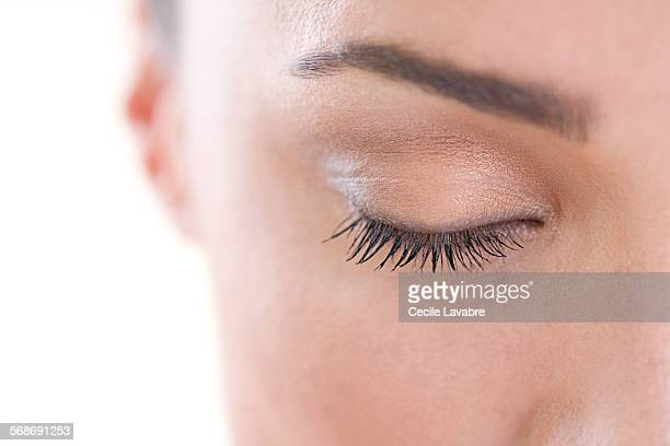 close-up of woman's closed eyes - eyelid stock photos and pictures