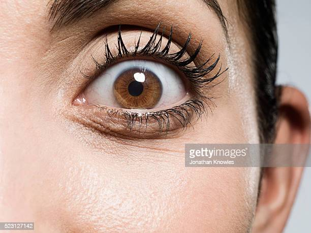 close-up of woman's eye - extreme close up stock pictures, royalty-free photos & images