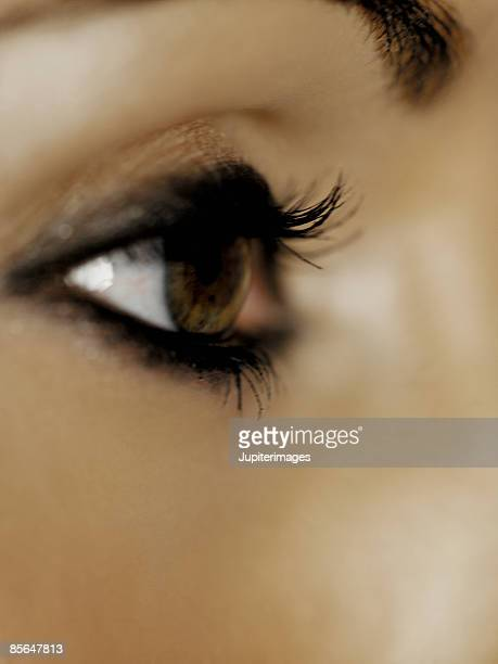 close-up of woman's eye with make-up - eye liner stock photos and pictures