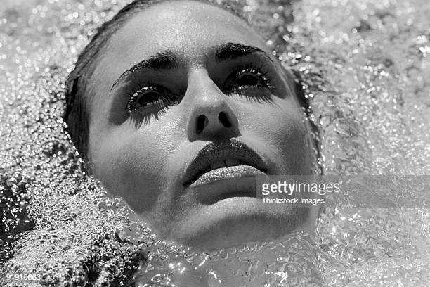 Close-up of woman's face surrounded by bubbles