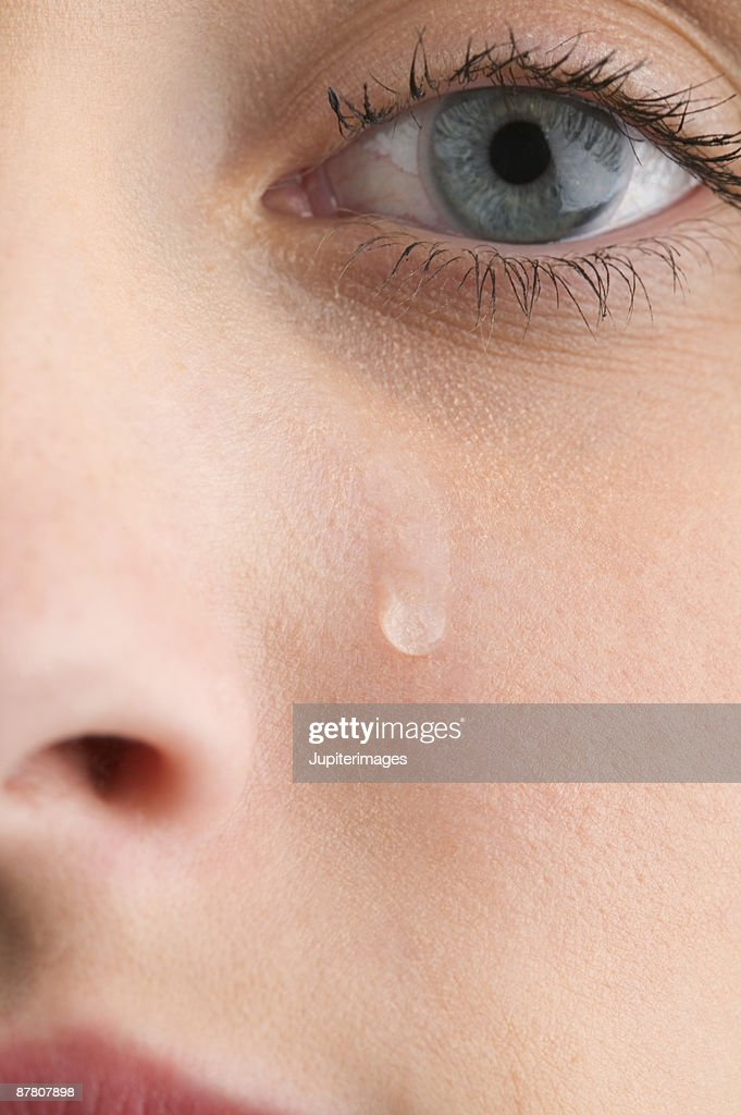 Close-up of woman's face with tear : Stock Photo