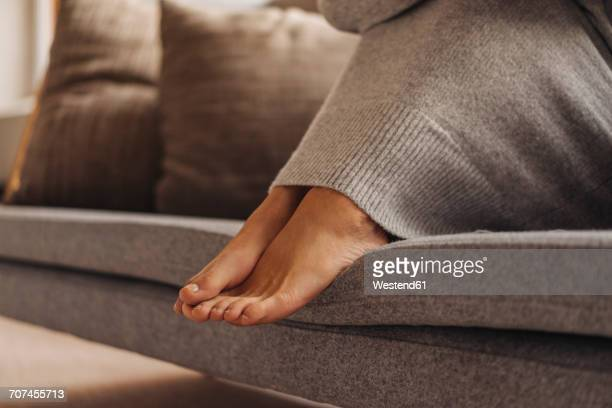 close-up of woman's feet sitting on couch - cold temperature stock pictures, royalty-free photos & images