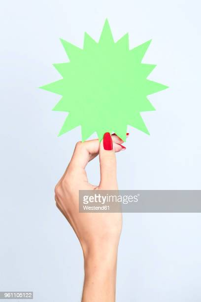 close-up of woman's hand holding a blank jagged sign - red nail polish stock pictures, royalty-free photos & images