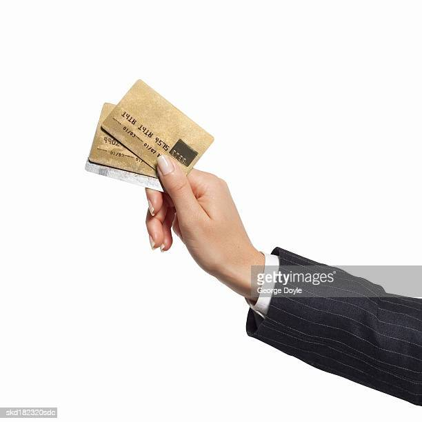 Close-up of woman's hand holding credit cards