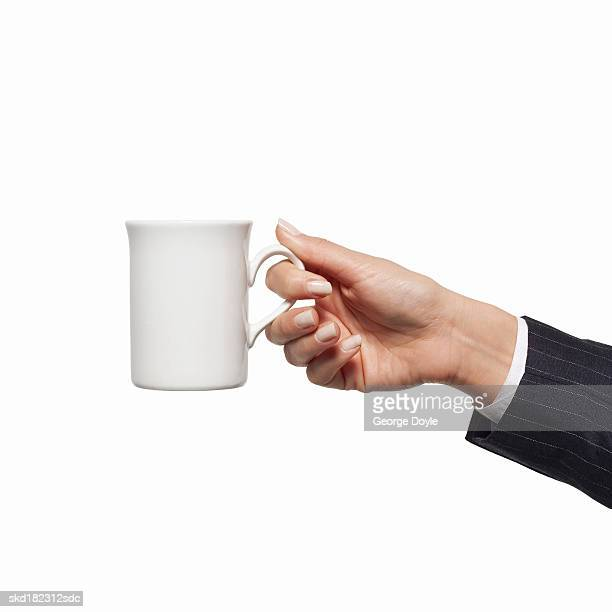 Close-up of woman's hand holding mug