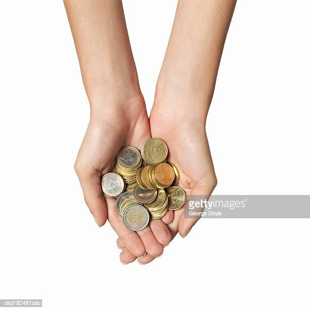 Close-up of woman's hands holding coins