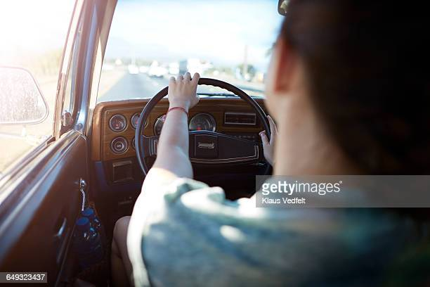 Close-up of womans hands on steeringwheel