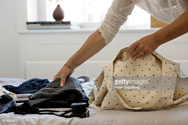 Closeup of Womans hands packing bag