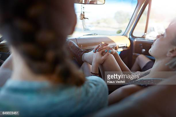 Close-Up of womans hands, sleeping in car