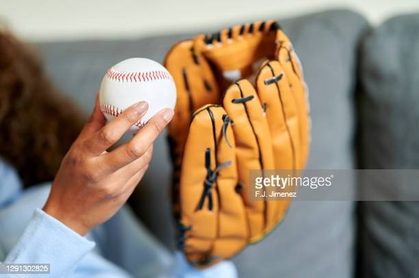 close-up of woman's hands with ball and baseball glove - 野球用グローブ ストックフォトと画像