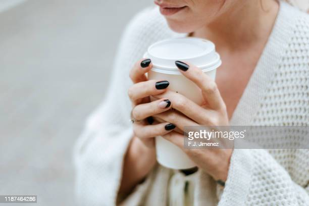 close-up of woman's hands with take away drink - fingernail stock pictures, royalty-free photos & images