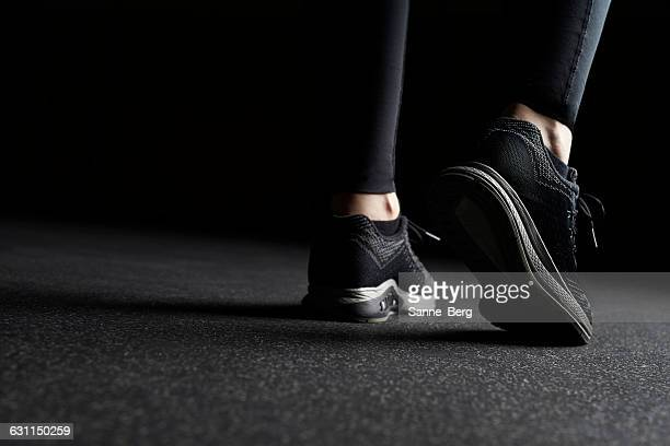 close-up of woman's legs in trainers at gym - low section stock pictures, royalty-free photos & images
