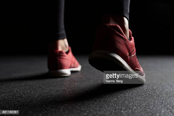 Close-up of Woman's legs in trainers at gym