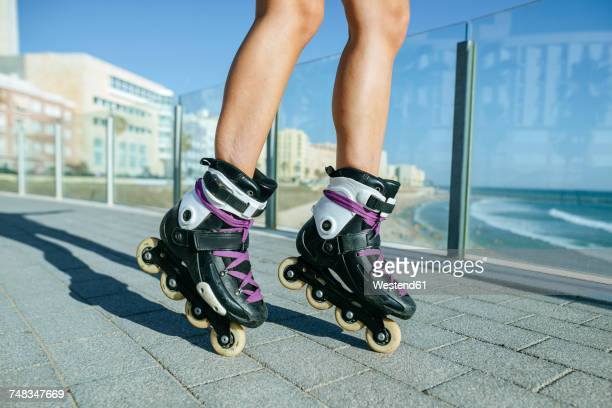 close-up of woman's legs with inline skates - inline skate stock photos and pictures