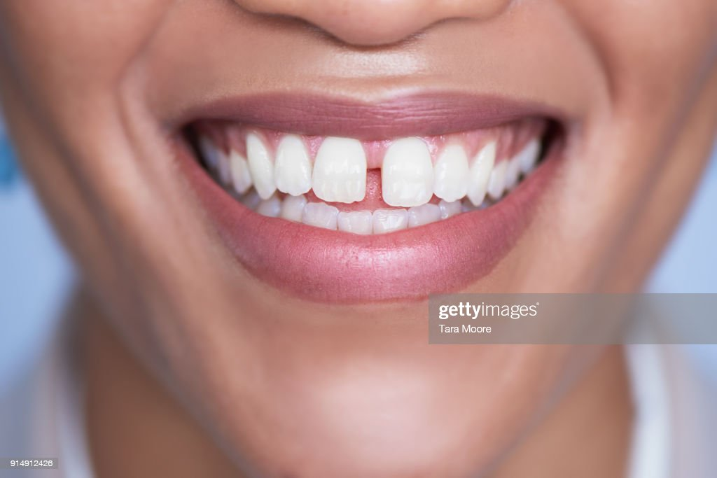 closeup of woman's mouth smiling : Stock Photo