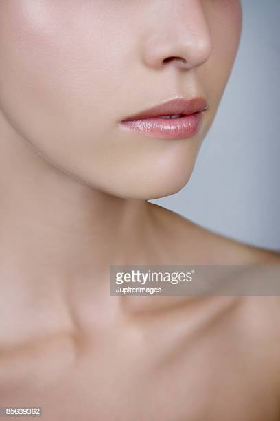 close-up of woman's neck and clavicles - clavicle stock photos and pictures