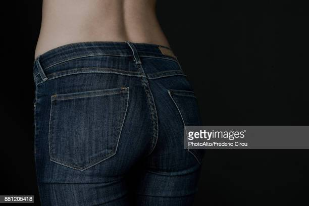 Close-up of womans rear end in jeans