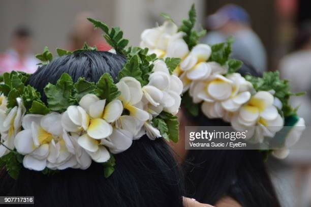 Close-Up Of Women Wearing Flowers