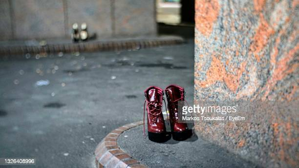 close-up of  womens shoes abandoned in an aley. - womenswear stock pictures, royalty-free photos & images