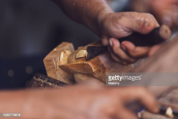 close-up of wood being manufactured by hand. hoi an, quang nam, vietnam. - carving craft product stock pictures, royalty-free photos & images
