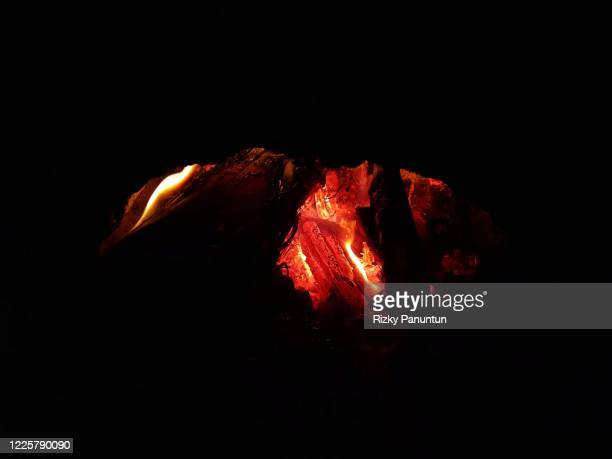 close-up of wood embers against black background - ember stock pictures, royalty-free photos & images