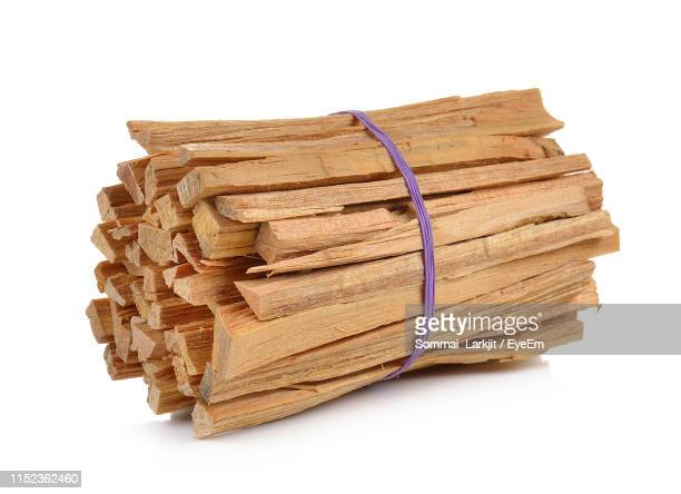 close-up of wood tied up against white background - bundle stock pictures, royalty-free photos & images