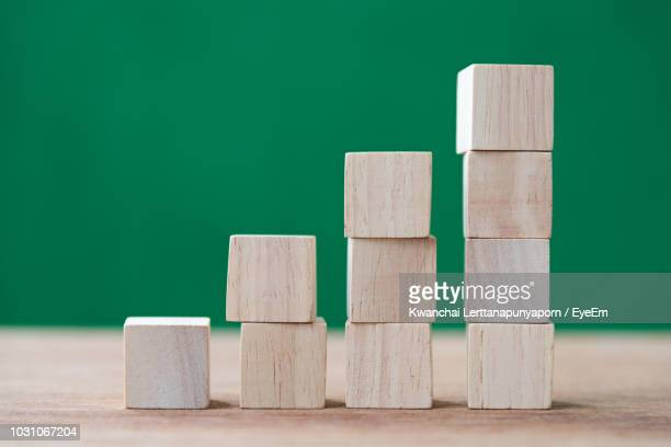 Close-Up Of Wooden Block Toys Stacked On Table
