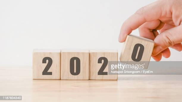 close-up of wooden blocks with number against white background - 2020 calendar stock photos and pictures