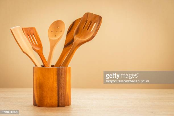 Close-Up Of Wooden Cooking Utensils On Table