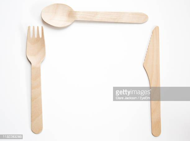 close-up of wooden cutlery over white background - disposable stock photos and pictures