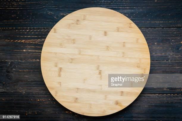 close-up of wooden cutting board on table - schneidebrett stock-fotos und bilder