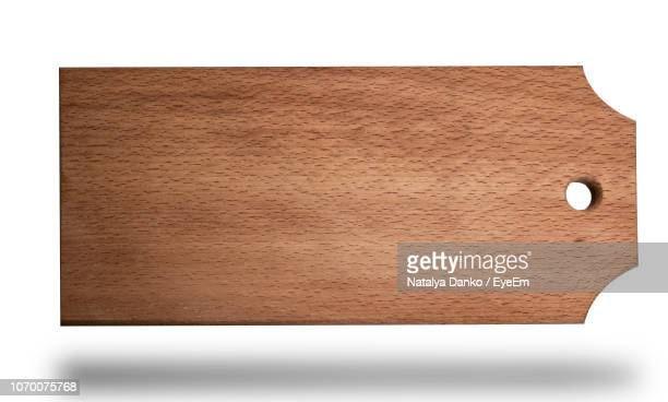 close-up of wooden cutting board on white background - single object stock pictures, royalty-free photos & images