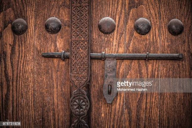 close-up of wooden door, bahrain - bahrain stock pictures, royalty-free photos & images