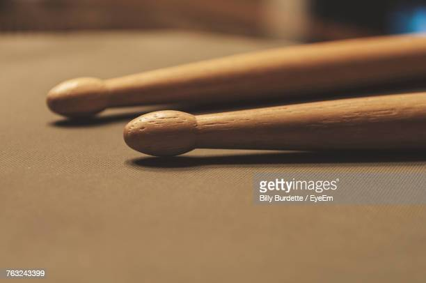 close-up of wooden drumsticks on table - drumstick stock photos and pictures