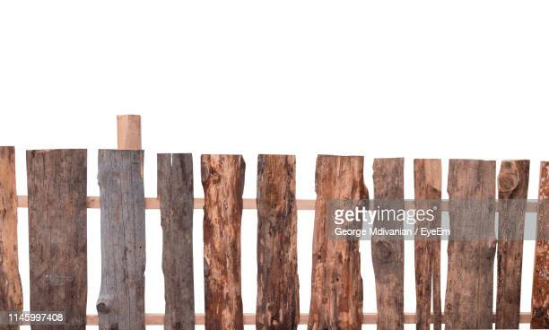 close-up of wooden fence against white background - george wood stock pictures, royalty-free photos & images