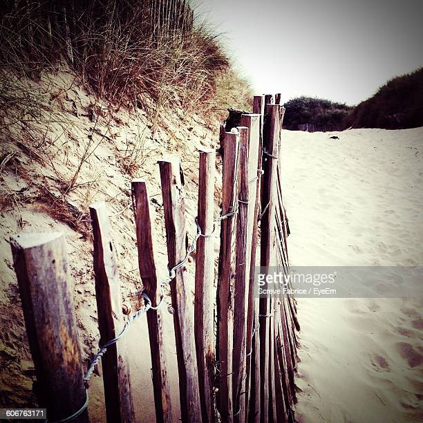 Close-Up Of Wooden Fence At Beach