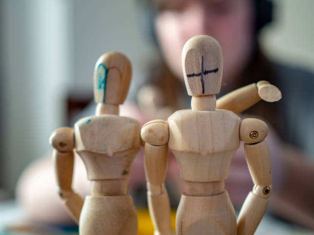 Close-Up Of Wooden Figures With Blurred Background