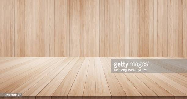 close-up of wooden floor against wall - 寄木張り ストックフォトと画像