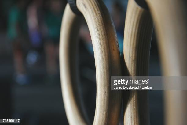 Close-Up Of Wooden Gymnastic Rings In Gym