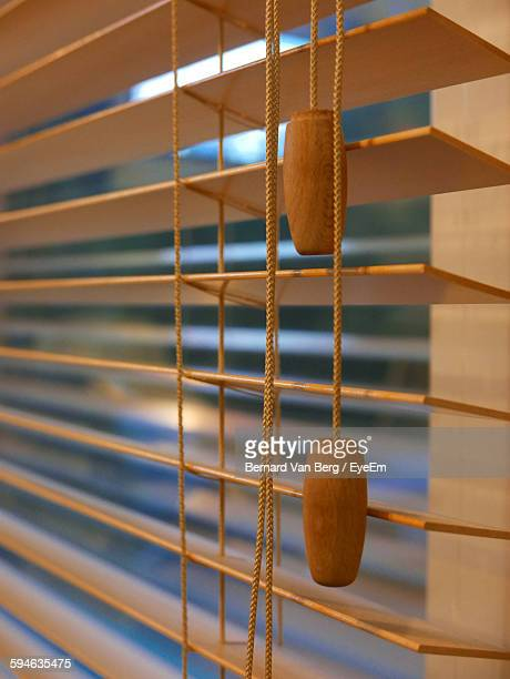 Close-Up Of Wooden Handles On Blinds Window