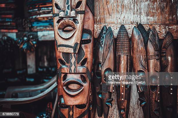 close-up of wooden masks for sale - south african culture stock photos and pictures