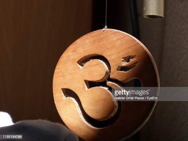 close-up of wooden om symbol - om symbol stock pictures, royalty-free photos & images
