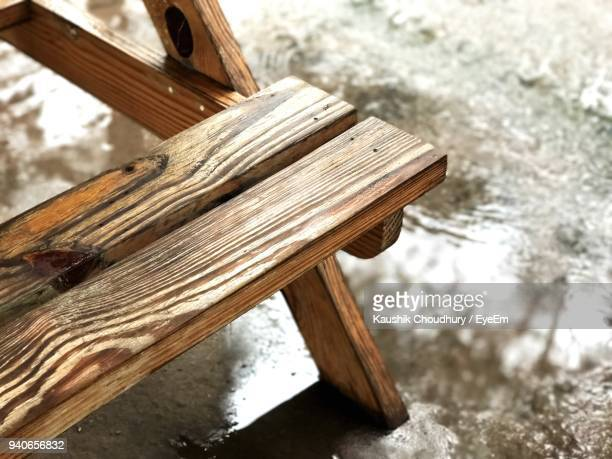 close-up of wooden picnic table - picnic table stock pictures, royalty-free photos & images