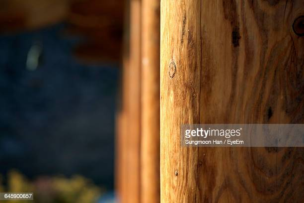 Close-Up Of Wooden Pillars In Row