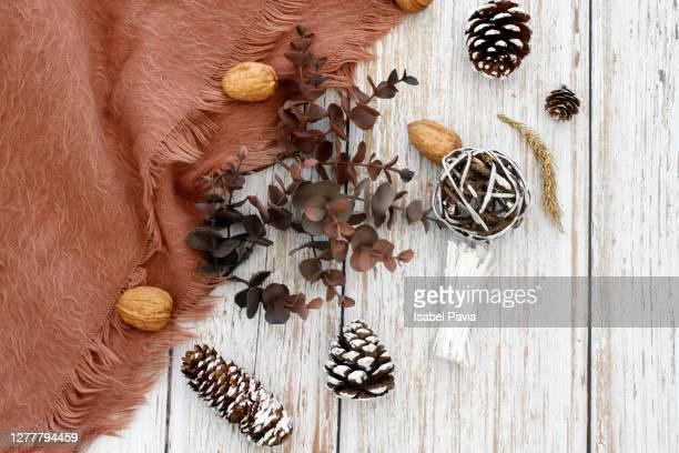 close-up of wooden pineapples on vintage background - herbst winter kollektion stock-fotos und bilder
