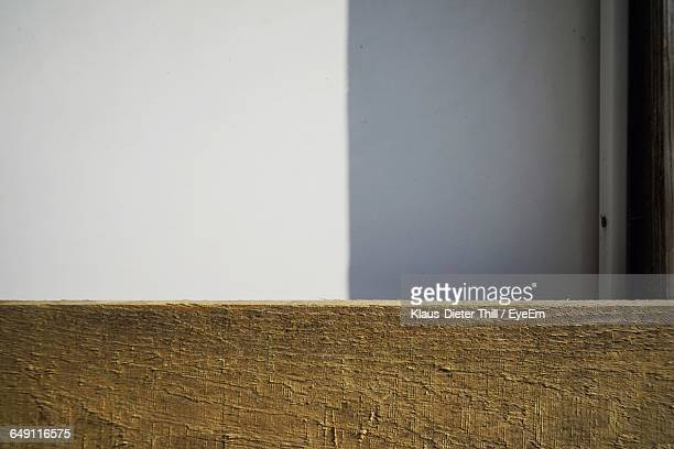 Close-Up Of Wooden Plank Against Wall