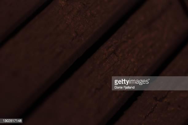 closeup  of wooden planks seen diagonally at nighttime - dorte fjalland fotografías e imágenes de stock